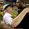 Arizona State's Dennis Erickson, left, hugs Colorado's Jon Embree after an NCAA college football game Saturday, Oct. 29, 2011, in Tempe, Ariz.  Arizona State defeated Colorado 48-14. (AP Photo/Ross D. Franklin)