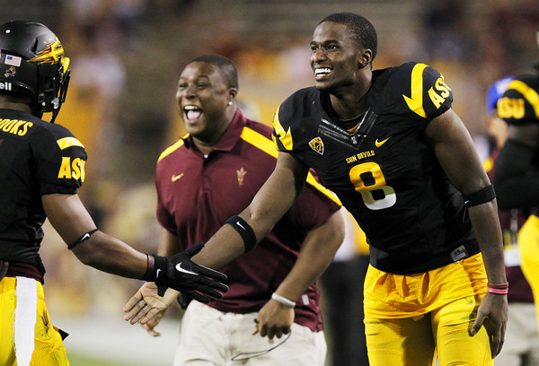 Arizona State's Gerell Robinson (8) joins others on the team bench in celebrating a touchdown against Colorado as Arizona State's Kyle Middlebrooks, far, left, comes off the field in the fourth quarter of an NCAA college football game Saturday, Oct. 29, 2011, in Tempe, Ariz.  Arizona State defeated Colorado 48-14. (AP Photo/Ross D. Franklin)