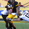 Colorado's Chidera Uzo-Diribe, rear left, forces a fumble on Arizona State's Brock Osweiler, center, as Colorado's Patrick Mahnke comes in for a tackle during the second quarter of an NCAA college football game Saturday, Oct. 29, 2011, in Tempe, Ariz. Arizona State recovered the fumble. (AP Photo/Ross D. Franklin)