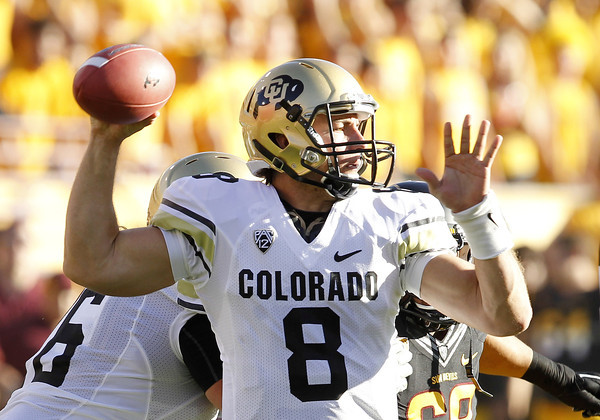 Colorado's Nick Hirschman (8) drops back to pass against Arizona State in the first quarter of an NCAA college football game Saturday, Oct. 29, 2011, in Tempe, Ariz.  (AP Photo/Ross D. Franklin)
