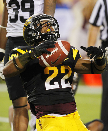 Arizona State's James Morrison (22) celebrates his touchdown against  Colorado in the fourth quarter of an NCAA college football game, Saturday, Oct. 29, 2011, in Tempe, Ariz. Arizona State defeated Colorado 48-14. (AP Photo/Ross D. Franklin)