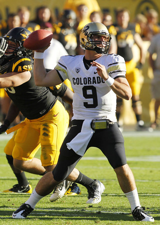 Colorado's Tyler Hansen (9) makes a throw against Arizona State in the first quarter of an NCAA college football game Saturday, Oct. 29, 2011, in Tempe, Ariz.  Arizona State defeated Colorado 48-14. (AP Photo/Ross D. Franklin)