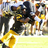 Arizona State's Clint Floyd, bottom, upends Colorado's Malcolm Creer in the first quarter of an NCAA college football game Saturday, Oct. 29, 2011, in Tempe, Ariz.  (AP Photo/Ross D. Franklin)