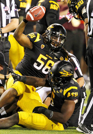 Arizona State's Grandville Taylor (56) celebrates with teammate Shelly Lyons after recovering a fumble against Colorado in the third quarter of an NCAA college football game Saturday, Oct. 29, 2011, in Tempe, Ariz.  Arizona State defeated Colorado 48-14. (AP Photo/Ross D. Franklin)