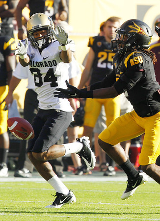 Arizona State's Eddie Elder, right, attempts to intercept a pass intended for Colorado's Alex Wood (84) during the first quarter of an NCAA college football game Saturday, Oct. 29, 2011, in Tempe, Ariz.  (AP Photo/Ross D. Franklin)