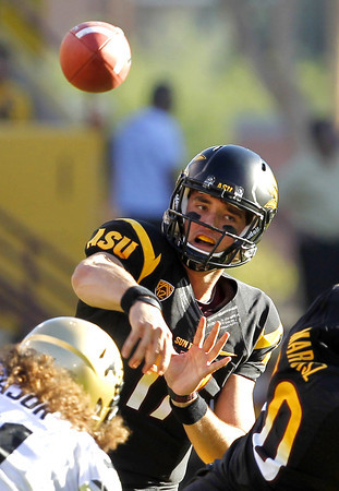 Arizona State's Brock Osweiler completes a pass against Colorado in the first quarter of an NCAA college football game Saturday, Oct. 29, 2011, in Tempe, Ariz.  (AP Photo/Ross D. Franklin)