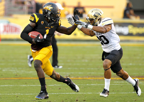 Arizona State's Mike Willie (1) rushes against Colorado's Greg Henderson in the second quarter of an NCAA college football game Saturday, Oct. 29, 2011, in Tempe, Ariz.  (AP Photo/Ross D. Franklin)