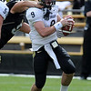 Tyler Hansen tries to avoid a sack in the CU Spring game on Saturday.<br /> Cliff Grassmick / April 10, 2010