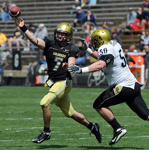 Cody Hawkins gets off a pass around Curtis Cunningham during the CU Spring game. Cliff Grassmick / April 10, 2010