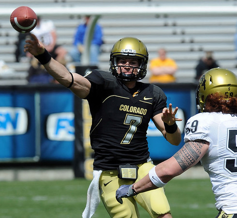 Cody Hawkins gets off a pass around B.J. Beaty during the CU Spring game.<br /> Cliff Grassmick / April 10, 2010