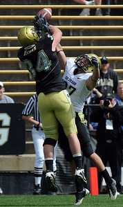 Vince Ewing (27) breaks up a pass for Ryan Deehan during the CU Spring game on Saturday. Cliff Grassmick / April 10, 2010