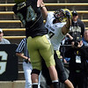 Vince Ewing (27) breaks up a pass for Ryan Deehan during the CU Spring game on Saturday.<br /> Cliff Grassmick / April 10, 2010