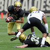 Dustin Ebner is looks for room to run during the CU Spring game on Saturday.<br /> Cliff Grassmick / April 10, 2010