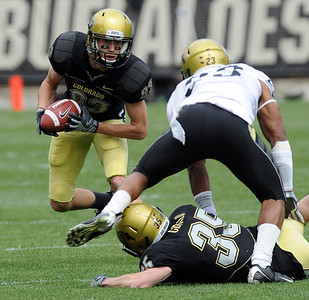 Dustin Ebner is looks for room to run during the CU Spring game on Saturday. Cliff Grassmick / April 10, 2010