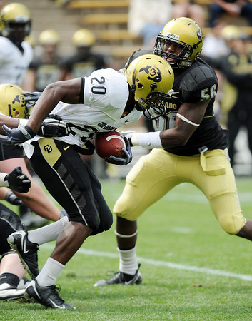 Brian Lockridge tries to get through  Derrick Webb during a run in the 2010 CU Spring game.<br /> Cliff Grassmick / April 10, 2010