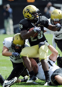 Quentin Hildreth tries to spin out of a tackle by  Jon Major during the CU Spring game on Saturday. Cliff Grassmick / April 10, 2010