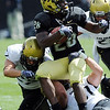 Quentin Hildreth tries to spin out of a tackle by  Jon Major during the CU Spring game on Saturday.<br /> Cliff Grassmick / April 10, 2010