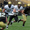 CU QB, Tyler Hansen, breaks away on a scramble during the CU Spring game.<br /> Cliff Grassmick / April 10, 2010
