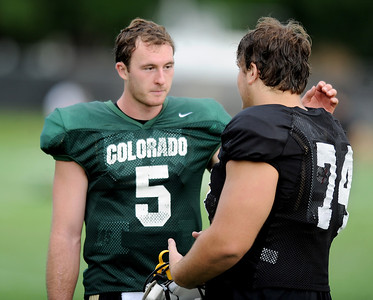 QB Connor Wood with Alex Kelly at CU practice on Saturday. For more photos and videos of media day,  go to www.dailycamera.com. Cliff Grassmick / August 11, 2012