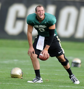 QB Nick Hirschman has a laugh at CU practice on Saturday. For more photos and videos of media day,  go to www.dailycamera.com. Cliff Grassmick / August 11, 2012