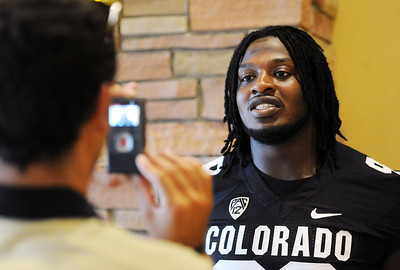 Nate Bonsu answers questions from the press during CU Football Media Day on Saturday. For more photos and videos of media day and practice, go to www.dailycamera.com. Cliff Grassmick  / August 11, 2012