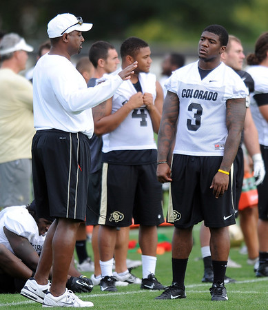 """Jon Embree and Doug Rippy talks during practice on Saturday.<br /> For more photos and videos of media day,  go to  <a href=""""http://www.dailycamera.com"""">http://www.dailycamera.com</a>.<br /> Cliff Grassmick / August 11, 2012"""