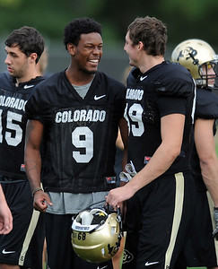 Jeff Thomas (9) at CU practice on Saturday. For more photos and videos of media day,  go to www.dailycamera.com. Cliff Grassmick / August 11, 2012
