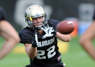 Nelson Spruce of CU catches passes at Saturday's practice. For more photos and videos of media day,  go to www.dailycamera.com. Cliff Grassmick / August 11, 2012