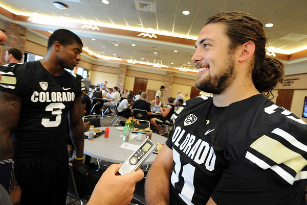 "Jon Major, right, answers questions from the press during CU Football Media Day on Saturday.<br /> For more photos and videos of media day and practice, go to  <a href=""http://www.dailycamera.com"">http://www.dailycamera.com</a>.<br /> Cliff Grassmick  / August 11, 2012"
