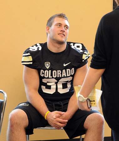 """Clay Norgard answers questions from the press during CU Football Media Day on Saturday.<br /> For more photos and videos of media day and practice, go to  <a href=""""http://www.dailycamera.com"""">http://www.dailycamera.com</a>.<br /> Cliff Grassmick  / August 11, 2012"""