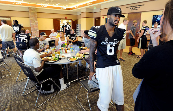 "Paul Richardson answers questions from the press during CU Football Media Day on Saturday.<br /> For more photos and videos of media day and practice, go to  <a href=""http://www.dailycamera.com"">http://www.dailycamera.com</a>.<br /> Cliff Grassmick  / August 11, 2012"