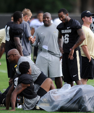 "Eric Bieniemy, left and Paul Richardson at CU practice on Saturday.<br /> For more photos and videos of media day,  go to  <a href=""http://www.dailycamera.com"">http://www.dailycamera.com</a>.<br /> Cliff Grassmick / August 11, 2012"