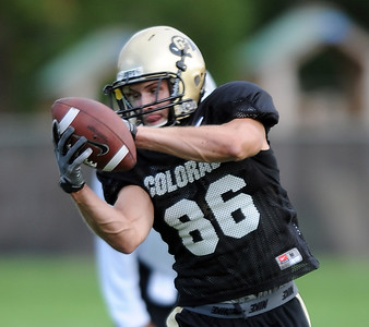 Alex Tuurbow of  CU catches passes at Saturday's practice. For more photos and videos of media day,  go to www.dailycamera.com. Cliff Grassmick / August 11, 2012