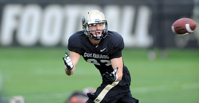 Tyler McCulloch of CU catches passes at Saturday's practice.For more photos and videos of media day,  go to www.dailycamera.com. Cliff Grassmick / August 11, 2012