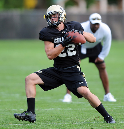"""Nelson Spruce of CU catches passes at Saturday's practice.For more photos and videos of media day,  go to  <a href=""""http://www.dailycamera.com"""">http://www.dailycamera.com</a>.<br /> Cliff Grassmick / August 11, 2012"""