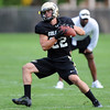 "Nelson Spruce of CU catches passes at Saturday's practice.For more photos and videos of media day,  go to  <a href=""http://www.dailycamera.com"">http://www.dailycamera.com</a>.<br /> Cliff Grassmick / August 11, 2012"