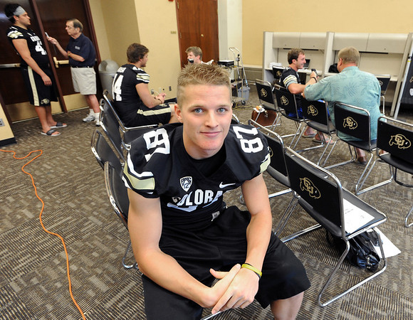 "Tyler McCulloch waits for the next reporter during CU Football Media Day on Saturday.<br /> For more photos and videos of media day and practice, go to  <a href=""http://www.dailycamera.com"">http://www.dailycamera.com</a>.<br /> Cliff Grassmick  / August 11, 2012"