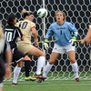 """Amy Barczuk (10) of CU, tries to help keeper,  Annie Brunner, guard the goal from Shino Kunisawa of LIU-Brooklyn.<br /> For more photos of the game, go to  <a href=""""http://www.dailycamera.com"""">http://www.dailycamera.com</a>.<br /> Cliff Grassmick  / August 24, 2012"""