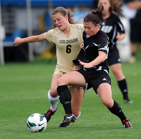 """Hayley Hughes, left, of CU, and Katie Egan of LIU-Brooklyn battle for the ball.<br /> For more photos of the game, go to  <a href=""""http://www.dailycamera.com"""">http://www.dailycamera.com</a>.<br /> Cliff Grassmick  / August 24, 2012"""