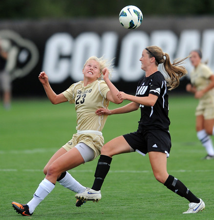"Anne Stuller, left, of CU, and Nicole Labo of LIU-Brooklyn, run down a ball in the Friday match.<br /> For more photos of the game, go to  <a href=""http://www.dailycamera.com"">http://www.dailycamera.com</a>.<br /> Cliff Grassmick  / August 24, 2012"