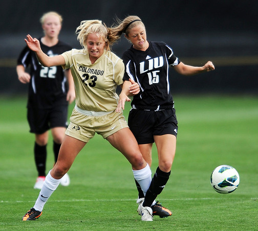 """Anne Stuller, left, of CU, and Nicole Labo of LIU-Brooklyn, battle for the ball in the Friday match.<br /> For more photos of the game, go to  <a href=""""http://www.dailycamera.com"""">http://www.dailycamera.com</a>.<br /> Cliff Grassmick  / August 24, 2012"""