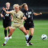 "Anne Stuller, left, of CU, and Nicole Labo of LIU-Brooklyn, battle for the ball in the Friday match.<br /> For more photos of the game, go to  <a href=""http://www.dailycamera.com"">http://www.dailycamera.com</a>.<br /> Cliff Grassmick  / August 24, 2012"