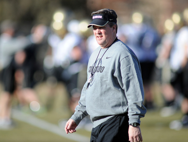 "New University of Colorado football coach, Mike MacIntyre, looks over the first Spring practice on Thursday.<br /> For more photos of practice, go to  <a href=""http://www.dailycamera.com"">http://www.dailycamera.com</a>.<br /> Cliff Grassmick  / March 6, 2013"