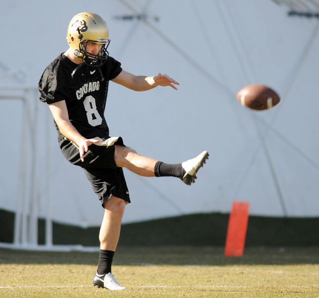 "Darragh O'Neill kicks during Spring practice on Thursday.<br /> For more photos of practice, go to  <a href=""http://www.dailycamera.com"">http://www.dailycamera.com</a>.<br /> Cliff Grassmick  / March 6, 2013"
