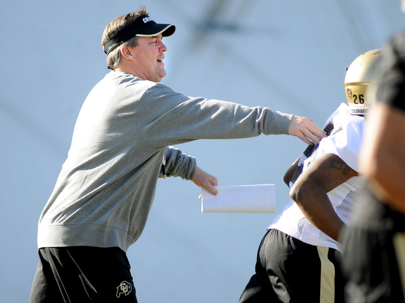 "New University of Colorado football coach, Mike MacIntyre, gives Tony Jones a playful pat on the bag during the first Spring practice on Thursday.<br /> For more photos of practice, go to  <a href=""http://www.dailycamera.com"">http://www.dailycamera.com</a>.<br /> Cliff Grassmick  / March 6, 2013"