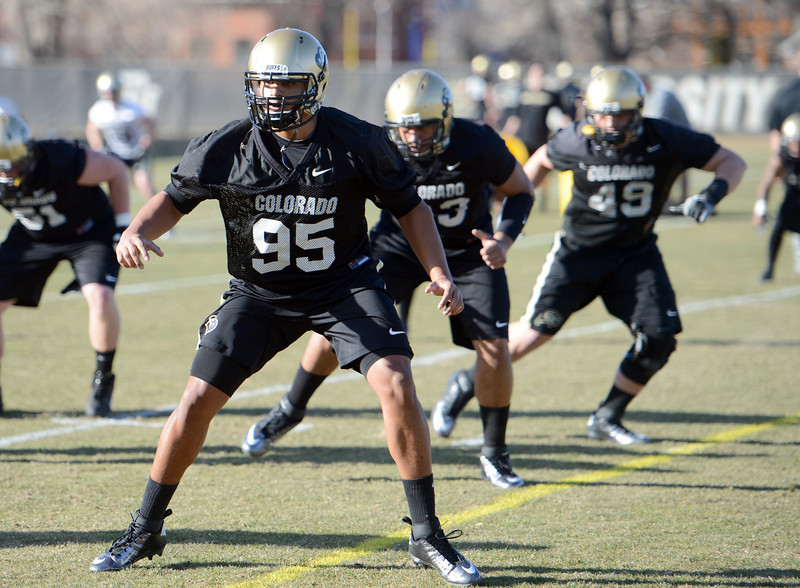 "Derek McCartney warms up  during the first CU Spring practice on Thursday.<br /> For more photos of practice, go to  <a href=""http://www.dailycamera.com"">http://www.dailycamera.com</a>.<br /> Cliff Grassmick  / March 6, 2013"