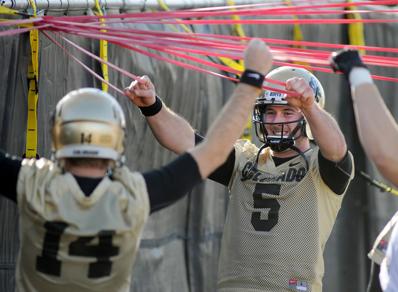 "CU quarterback, Connor Wood, works with the bands at the first Spring football practice on Thursday.<br /> For more photos of practice, go to  <a href=""http://www.dailycamera.com"">http://www.dailycamera.com</a>.<br /> Cliff Grassmick  / March 6, 2013"