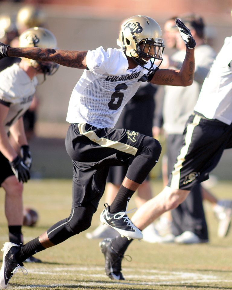 "Paul Richardson warms up during the first CU Spring practice on Thursday.<br /> For more photos of practice, go to  <a href=""http://www.dailycamera.com"">http://www.dailycamera.com</a>.<br /> Cliff Grassmick  / March 6, 2013"