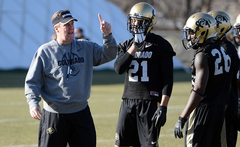 "New University of Colorado football coach, Mike MacIntyre, works with the DB's during the first Spring practice on Thursday.<br /> For more photos of practice, go to  <a href=""http://www.dailycamera.com"">http://www.dailycamera.com</a>.<br /> Cliff Grassmick  / March 6, 2013"