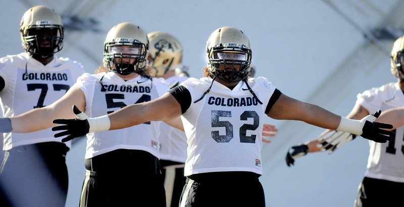 "Daniel Munyer  during the first CU Spring practice on Thursday.<br /> For more photos of practice, go to  <a href=""http://www.dailycamera.com"">http://www.dailycamera.com</a>.<br /> Cliff Grassmick  / March 6, 2013"